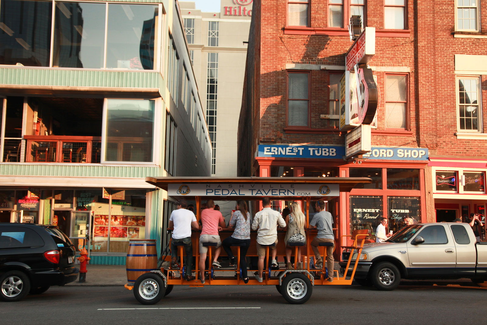 Pedal Tavern Boat moving through downtown Nashville - fun things to do in nashville, nashville attractions, nashville tourist attractions