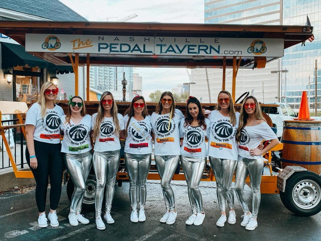 Pedal Tavern Girls Group Dressed as White Claws
