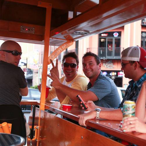 A group of young men enjoying a Nashville pub crawls on a Pedal Tavern boat.